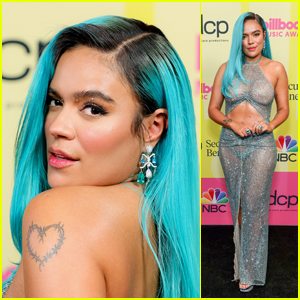 Karol G Rocks Bright Blue Hair & A Shimmering See-Through Look at the Billboard Music Awards 2021