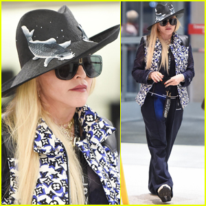 Madonna Wears Fish-Print Hat for Flight Out of NYC