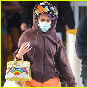 Cardi B Rocks a Floral Headband as She Arrives in NYC