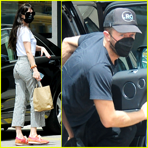 Dakota Johnson & Chris Martin Spotted Departing Spain After Their Vacation