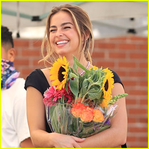 Addison Rae Picks Up A Bouquet of Flowers After 'He's All That' Premiere