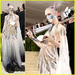 Grimes Carries A Sword & Wears Metal Mask To Met Gala 2021